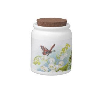 Tarro del caramelo de la mariposa con el lirio de  platos para caramelos
