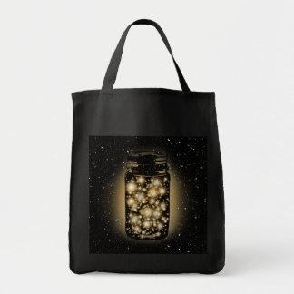 Tarro que brilla intensamente de luciérnagas con l bolsa tela para la compra