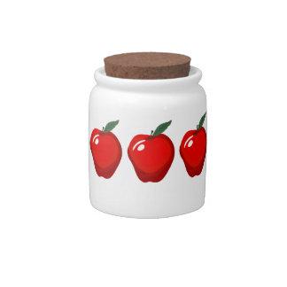 Tarro rojo de las manzanas platos para caramelos