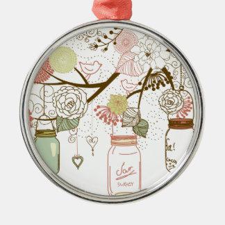 Tarros de albañil y flores bonitas adorno navideño redondo de metal