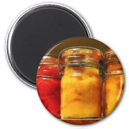Tarros de enlatado de tomates y de melocotones imán de frigorífico
