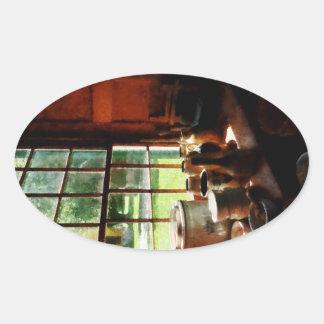 Tarros de la arcilla en Windowsill Pegatina De Ovaladas