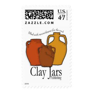 Tarros de la arcilla que publican el sello