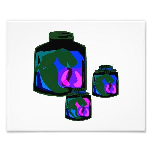 Tarros de pimientas de la púrpura del verde azul fotografías