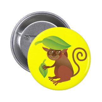 Tarsier hiding under a green leaf 2 inch round button