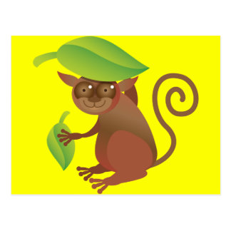 Tarsier hiding under a green leaf postcard