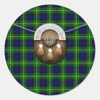 Tartán y escarcela de los montañeses de Escocia de Pegatina Redonda