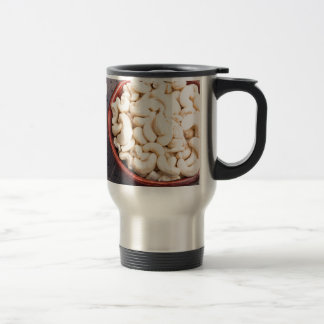 Tasty and healthy raw cashew nuts in a brown bowl travel mug