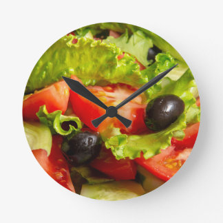 Tasty fresh salad of tomatoes, olives and cucumber round clock