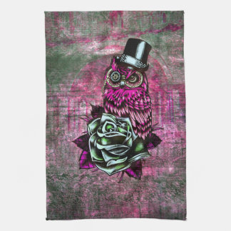 Tattoo style owl with top hat in pink and green hand towel