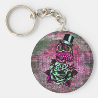 Tattoo style owl with top hat in pink and green keychain