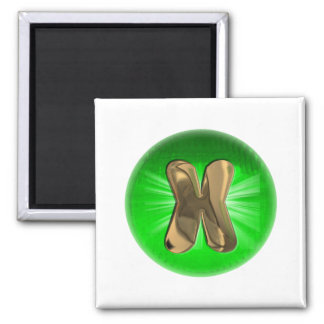 TAXI Gold Monogram X Green light Magnet