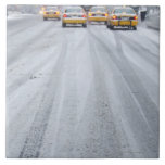 Taxis amarillos en ventisca tejas  ceramicas