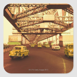 Taxi's on a Bridge Square Stickers