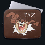 "TAZ™ Bursting Through Page Laptop Sleeve<br><div class=""desc"">LOONEY TUNES™ 