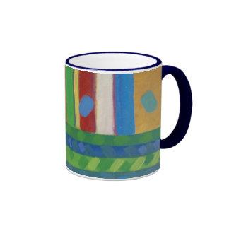 Taza abstracta de los colores