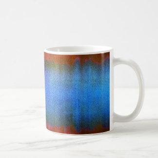 taza abstracta del grunge en azul y rojo