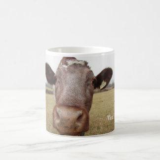 Taza adorable de la vaca