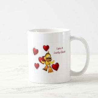Taza afortunada del amor del pato