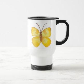 Taza amarilla del viaje de la mariposa