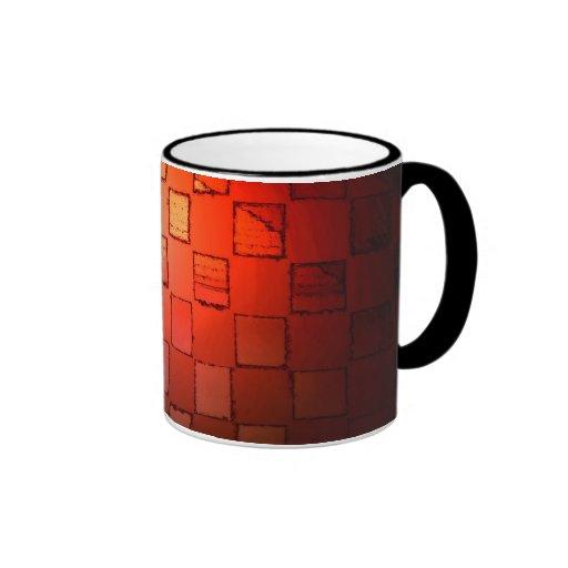 Taza anaranjada del cubo