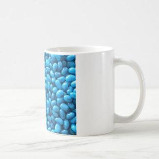 Taza azul de la haba de jalea