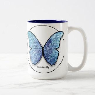 Taza azul de la mariposa del Grunge