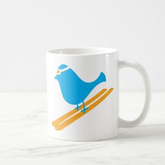 Taza azul del día del pájaro