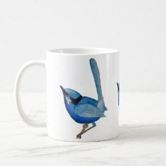 Taza azul del pájaro