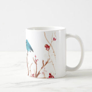 Taza azul del pájaro y de café de las bayas