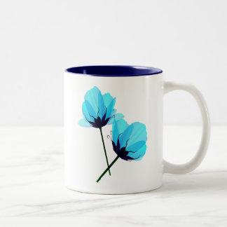 Taza azul eléctrica de la flor dos