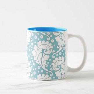 Taza azul elegante del damasco