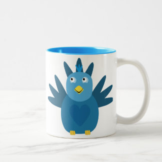 Taza azul linda del pájaro