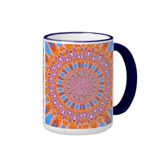 Taza azul y anaranjada del arte del girasol