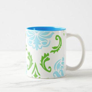 Taza azul y verde del damasco