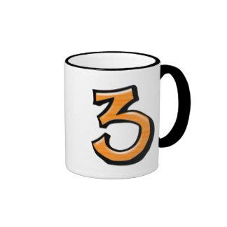 Taza blanca anaranjada del número 3 tontos