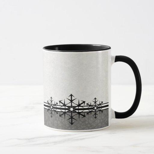 Taza blanco y negro del copo de nieve del día de
