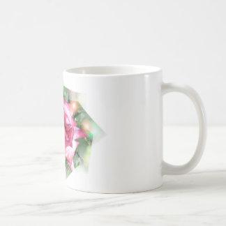 Taza brillante de la flor