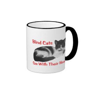 Taza ciega del gato