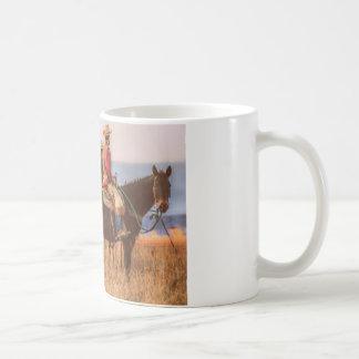 Taza clásica del vaquero y del caballo