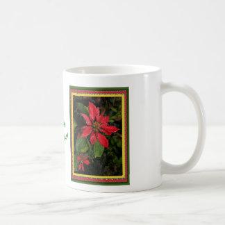 Taza colorida, alegre del Poinsettia