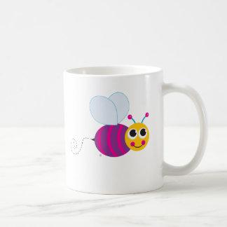 Taza colorida de la abeja