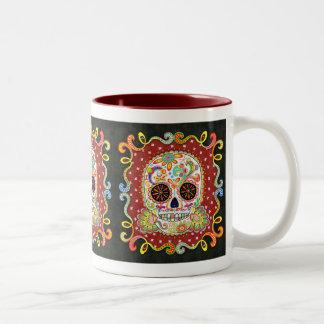 Taza colorida del arte del cráneo del azúcar