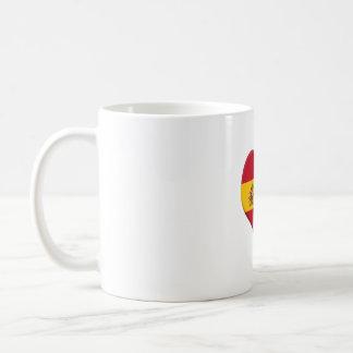 Taza con bandera de España en forma de corazón.