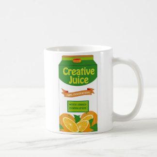 Taza creativa del cartón del jugo