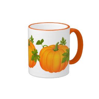 Taza de café anaranjada de la calabaza de la caída