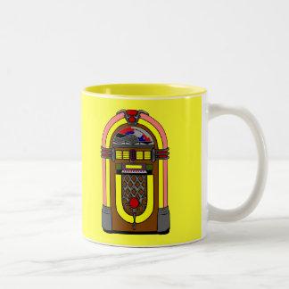 Taza de café Aseada-o retra de la máquina tocadisc