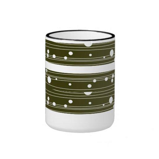 Taza de café blanca del modelo de lunar