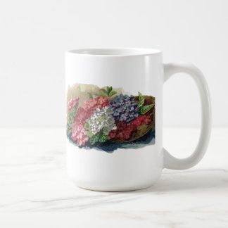 Taza de café colorida de las verbenas del vintage