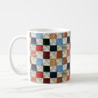 Taza de café colorida del modelo del edredón